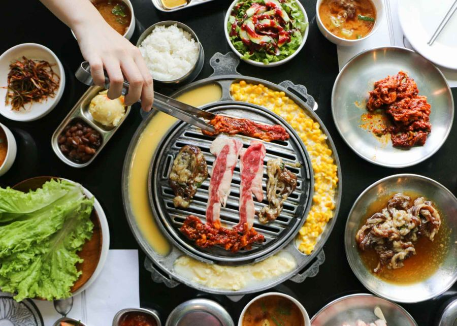 A traditional Korean Barbecue restaurant, with the grill on the table