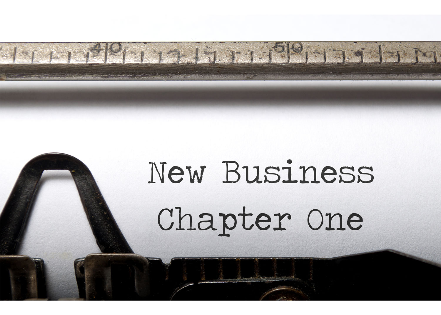 "A typewriter typing the following words on paper, ""New Business Chapter One"""